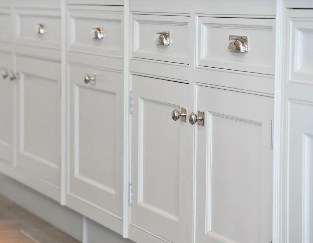 Silver knobs on cabinets